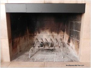 The smoke guard is a metal barrier that fits into the top of your fireplace opening.