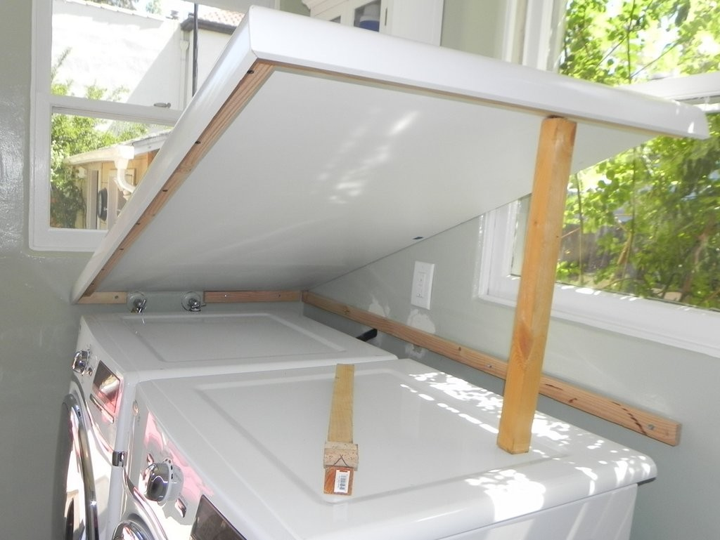 This shows how the counter doesn't have to be fastened into place - it sits atop the ledger board, as well as support boards resting on the top of the washer and dryer.